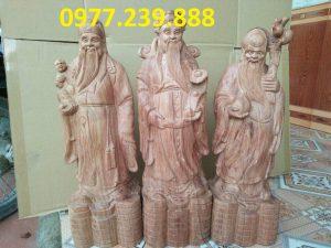 tượng thần tài bằng gỗ bách xanh