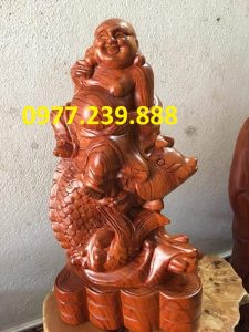 tượng di lặc cưỡi cá bằng gỗ hương 40cm