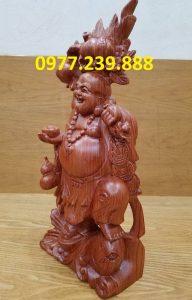 tượng phật di lặc gánh đào cưỡi cá chép bằng gỗ hương đỏ