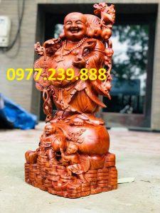 tượng phật di lặc gánh cành đào gỗ hương ta